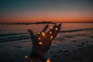 person with string lights on left hand
