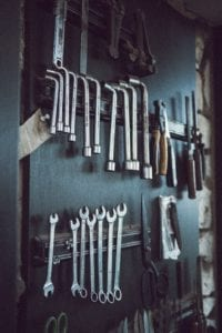 assorted hand tools on wall
